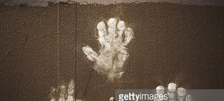Close-Up Of Handprints On Wall