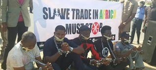 #Libya slave trade: Charlyboy group storms Foreign Affairs in chains and handcuffs