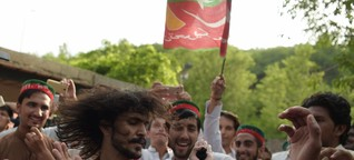 Imran Khan's supporters dance in the street as former cricketer declares victory